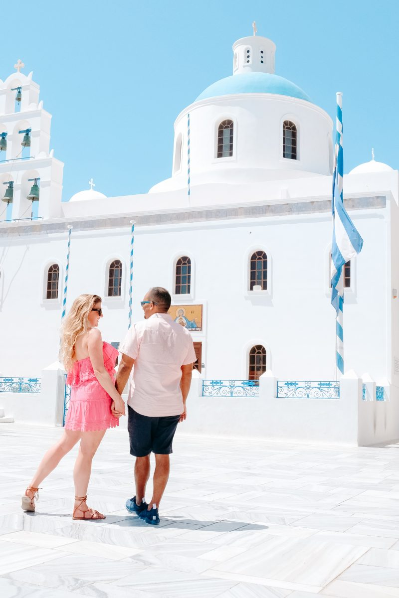 Couple Standing in Front of Temple in Santorini Greece